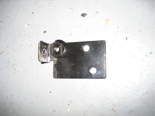 Modified oil dipstick tube bracket